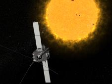Artist concept of one of the STEREO spacecraft observing the sun.