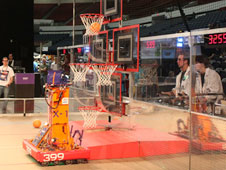 Lancaster High School's robot, the X-1, shoots high and scores another basket at the San Diego FIRST regional.