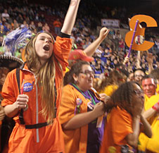 Eagle Robotics' Sarah Ritter, Kayla Barbosa and Annelise Williams (from left) celebrate after the regional win at Denver.