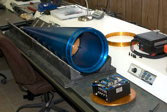 The NASA payload, the Suborbital Flight Environment Monitor (SFEM),awaits installation and integration with the nose cone of UP Aerospace' SL-6 rocket.