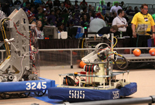 Tehachapi High's Vesuvius robot (585) mixes it up during competition as a judge (in yellow shirt) monitors play at the FIRST Robotics regional competition in Las Vegas April 6.