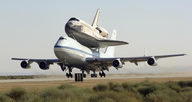 NASA's modified Boeing 747 Shuttle Carrier Aircraft 905 with Space Shuttle Discovery on top lifts off from Edwards Air Force Base to begin its ferry flight back to the Kennedy Space Center in Florida on August 19, 2005,