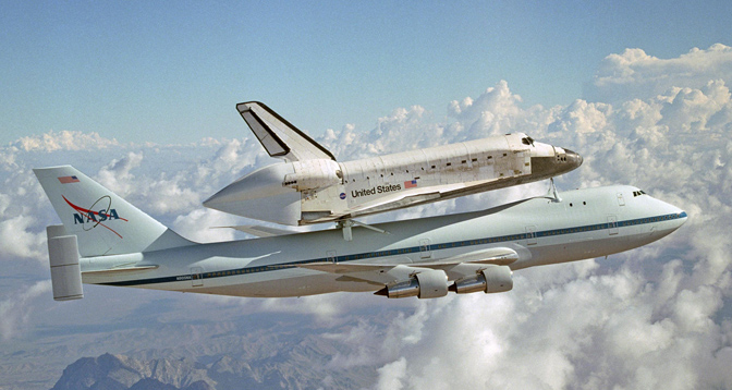 Space Shuttle Discovery was carried atop NASA's modified Boeing 747 Shuttle Carrier Aircraft 905 for the ferry flight from NASA's Dryden Flight Research Center in California to Kennedy Space Center, Florida, on August 19, 2005.