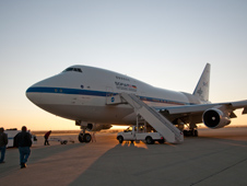 Ground crewmen approach NASA's SOFIA flying observatory shortly after the modified Boeing 747SP carrying a 100-inch telescope landed following an all-night astronomical observation mission.