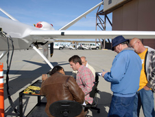 Engineers and technicians check the ADS-B equipment following its installation on the Ikhana unmanned aircraft.