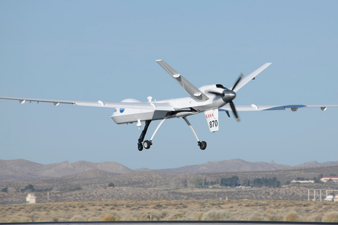 NASA's Ikhana glides in for landing at the conclusion of the first checkout test flight of the new ADS-B Automatic Dependent Surveillance-Broadcast aircraft tracking technology on an unmanned aircraft system.