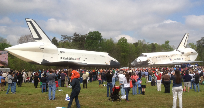 Attendees at ceremonies that officially transferred Discovery to the Smithsonian's National Air and Space Museum at the Stephen F. Udvar-Hazy Center in Chantilly, Va., April 19 had the rare opportunity to see two retired space shuttles together – the prototype Enterprise on the left and Discovery on the right.
