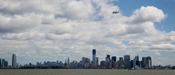 Space shuttle Enterprise, atop a NASA 747 Shuttle Carrier Aircraft, flies over the Hudson River and New York City.
