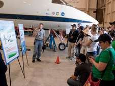 Dryden aerospace engineers Ethan Baumann and Natalie Spivey (at far left) outline the ACTE flexible-flap laminar-flow research project on the Gulfstream III test aircraft behind them to the NASA Social@Dryden participants.