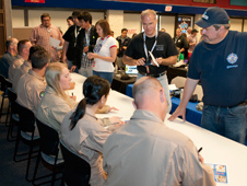 The autograph table staffed by Dryden pilots and flight test engineers (from left) Troy Asher, Jim Less, Herman Posada, Mark Pestana, Ashley Parham, Kate Pavlock and Nils Larson was a popular highlight of the NASA Social@Dryden.