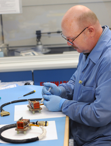 a technician works on MAVEN magnetometers