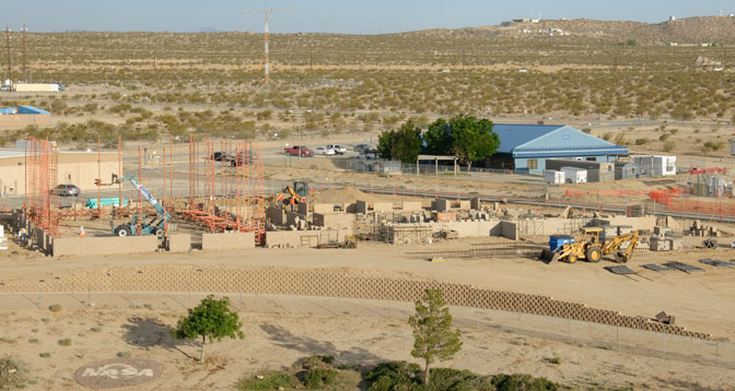 The concrete-block masonry walls of NASA Dryden's new Facilities Support Center are rising as captured in this photo taken May 23 from the top of Dryden's main building.