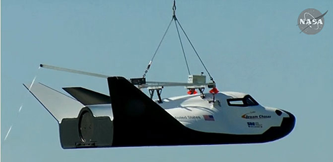 Sierra Nevada Space Systems' Dream Chaser prototype space-access vehicle dangled from a sling suspended from a large helicopter during a captive-carry flight test May 29.