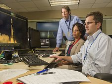 Paul Doyle, front, Yvette Binford and Ken King, standing, integrate and debug the SLS avionics software.