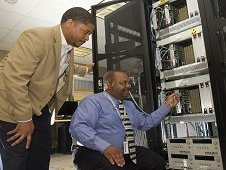 Markeeva Morgan, left, and Walter Robinson, integrate the software test beds into the laboratory at the Marshall Center.
