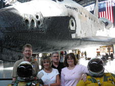 Kevin Rohrer, Mary Ann Harness, James Sokolik and Kimberlee Buter in front of the Discovery in its new location at the Smithsonian National Air and Space Museum.