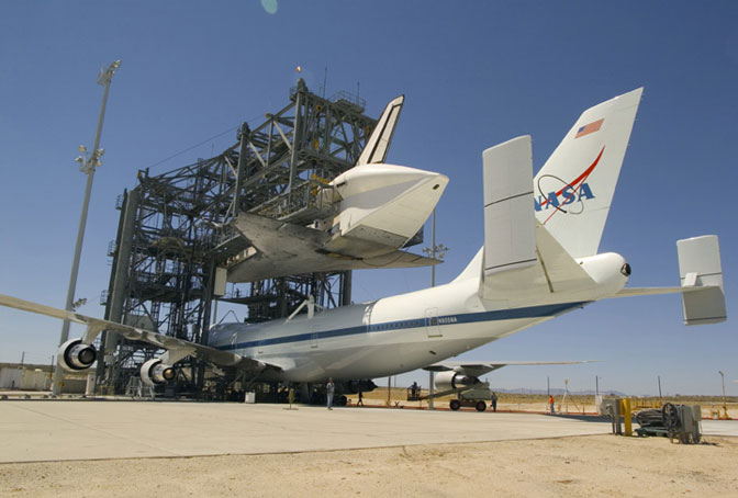 NASA's specially modified 747 Shuttle Carrier Aircraft, or SCA, is positioned under Discovery to be attached for a ferry flight to the Kennedy Space Center.