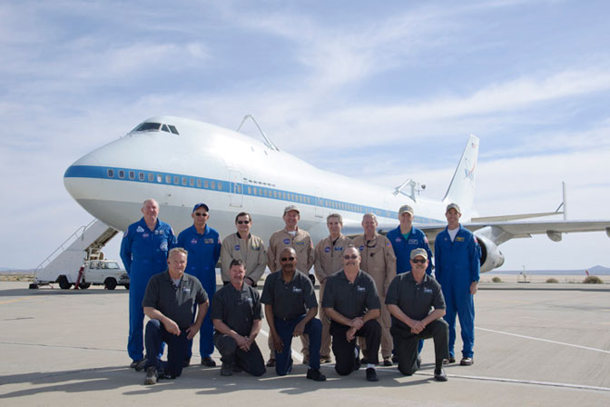 Eight of the nine pilots and flight engineers from the Johnson Space Center, Houston, and Dryden who have flown NASA's Shuttle Carrier Aircraft in recent years along with the SCA maintenance crew from Dryden were photographed prior to a pilot proficiency flight in NASA 747 SCA No. 905 March 29.