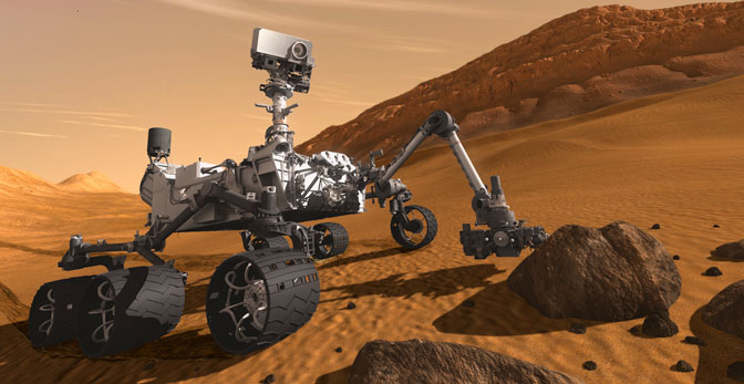 In this artist's concept, NASA's Mars Science Laboratory Curiosity rover examines a rock on Mars with a set of tools at the end of the rover's arm, which extends about seven feet.