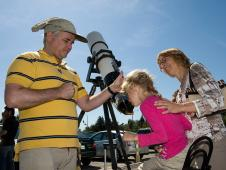 Kurt Kuhlmann (telescope owner) came to NASA Ames Research Center to assist public to see the transit of Venus. In this photo, Lena Leclerc looks through the telescope while her mother Margarete Leclerc smiles proudly at her.