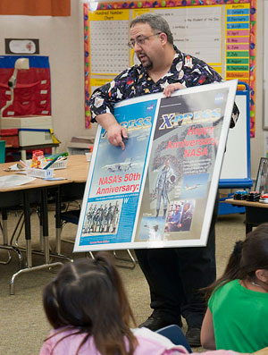 Jay Levine tells students how he designs the colorful covers of special editions newsletters.