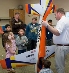 Jerry Budd shows off his competition model aircraft to students.