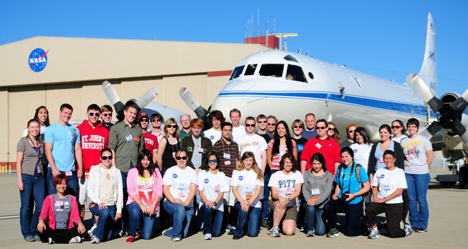More than 30 undergraduate and graduate students from a like number of colleges and universities gathered in front of NASA's P-3B Orion Earth science aircraft at the Dryden Aircraft Operations Facility in Palmdale, Calif., prior to a research mission June 25.