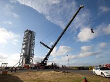 An inert Minotaur V launch vehicle is erected on the Mid-Atlantic Regional Spaceport's pad 0B at NASA's Wallops Flight Facility.