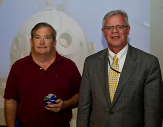 NASA Environmental Management Director James Leatherwood, right, presented the individual NASA Environmental Quality Award to NASA engineer Bryon Maynard during a ceremony Thursday at John C. Stennis Space Center. Maynard was recognized for his role in converting a 107,000-gallon liquid hydrogen sph