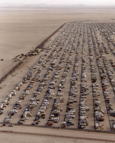 A huge crowd estimated at 500,000 persons and their vehicles assembled to watch the landing of STS-4 from the east shore public viewing site on Rogers Dry Lake at Edwards Air Force Base in California in July 1982.