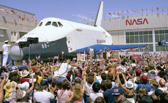 President Ronald Reagan acknowledges the cheers of thousands of flag-waving spectators gathered in front of the prototype space shuttle Enterprise at the back ramp at NASA's Dryden Flight Research Center following the landing of shuttle Columbia on the fourth shuttle shuttle mission, July 4, 1982.