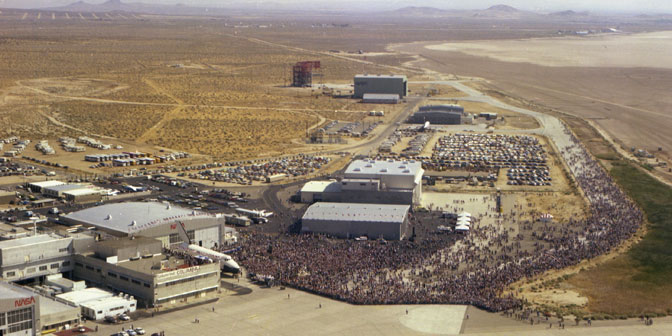 An estimated 45,000 visitors jammed the back ramp and taxiways at NASA's Dryden Flight Research Center on July 4, 1982 to hear congratulations from President Ronald Reagan following the historic Independence Day landing of space shuttle Columbia after the fourth shuttle mission.