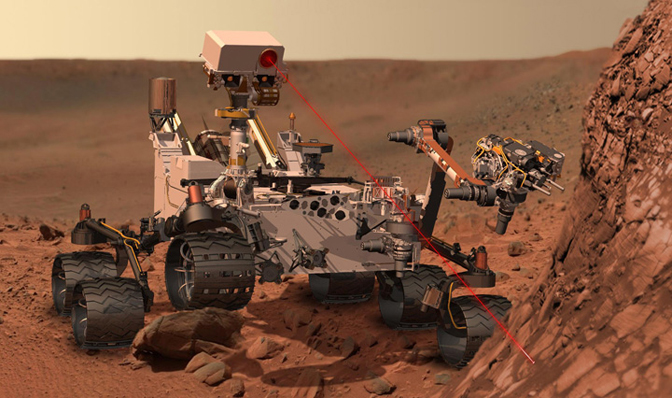 This artist's concept shows the Curiosity rover using its Chemistry and Camera, or ChemCam, instrument to investigate the composition of a rock surface.