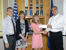 Accompanied by her parents, Michael and Jennifer Thomson, Rachel Thomson, recipient of the 2012 NASA Dryden Employee Exchange Scholarship, is congratulated by NASA Dryden Flight Research Center director David McBride.