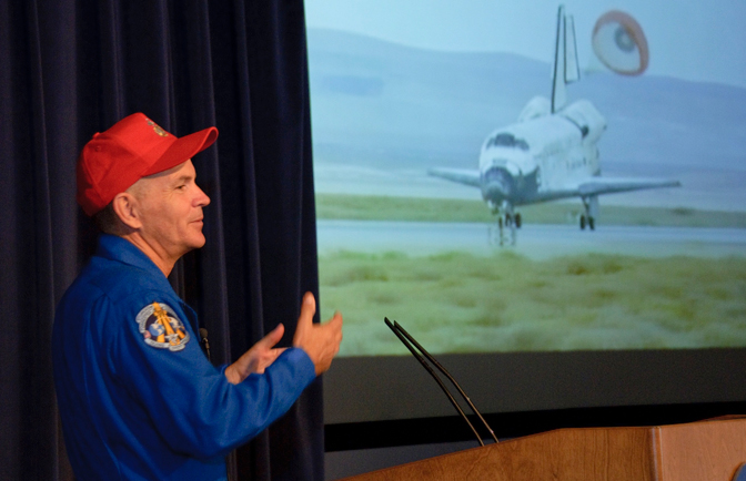 NASA astronaut Rick - C. J. - Sturckow, commander of space shuttle mission STS-128, outlined highlights of the 2009 flight during a presentation to employees of NASA's Dryden Flight Research Center at Edwards July 13.