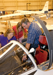 Dryden Flight Operations Engineer Mike Kapitzke (right) points out the experiment control panel for science instruments in the cockpit of NASA's ER-2 Earth resources aircraft to AREES program workshop participants Liz Petry (left) and Kathy Biernat (center).
