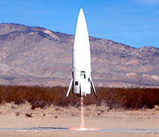 Masten Space Systems' Xaero sub-orbital rocket lifts off in a plume of fire during a test launch from the Mojave Air and Space Port in Mojave, Calif.