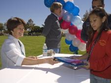 Sally Ride cheerfully signs autographs for girls at the Sally Ride Science Festival hosted by Ames in 2007.