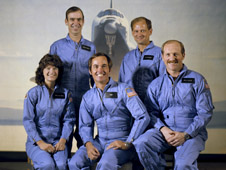 Sally Ride joined her fellow STS-7 crewmembers for their official mission portrait in March 1983, three months prior to launch. Beside Ride at left are STS-7 commander Robert L. Crippen and pilot Frederick H. Hauch. Standing behind are mission specialists John M. Fabian and Norman E. Thagard.