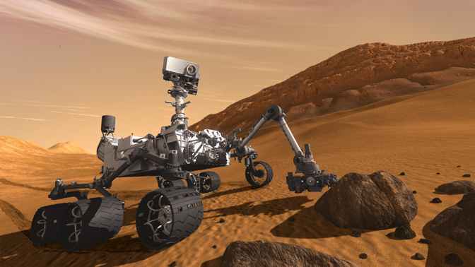 In this artist's concept, NASA's Mars Science Laboratory Curiosity rover examines a rock on Mars with a set of tools at the end of the rover's arm, which extends about seven feet. The rover is designed to investigate Mars' past or present ability to sustain microbial life.