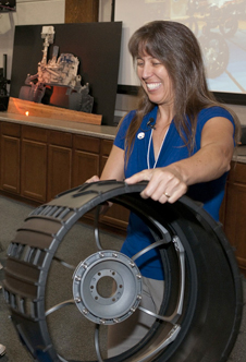 A plastic demonstration replica of one of the Curiosity rover's six wheels was used by NASA's Mars program scientist Dr. Kelly Fast during her three presentations on NASA's Mars Science Laboratory mission.