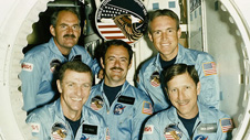 Joe Engle, at lower left, led a five-member shuttle crew on mission STS-51-I in 1985, including pilot Richard Covey (lower right) and mission specialists (top row, from left) James van Hoften, Mike Lounge and William Fisher.