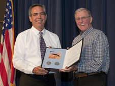 NASA Dryden center director David McBride presents a certificate to Joe Engle from the International Astronomical Union naming an asteroid in honor of the retired Air Force test pilot and NASA astronaut following Engle's colloquium presentation on the X-15 at Dryden.