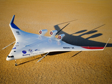 Boeing's sub-scale X-48B Blended Wing Body technology demonstrator rests on the cracked surface of Rogers Dry Lake at Edwards Air Force Base before beginning its flight test program.