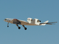 The X-48C Hybrid / Blended Wing Body technology demonstrator lifts into the skies after taking off from the bed of Rogers Dry Lake at Edwards Air Force Base on its first test flight.