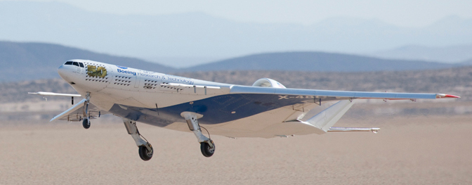 The remotely operated X-48C Blended Wing Body aircraft lifts off Rogers Dry Lake at Edwards Air Force Base, Calif., on its first test flight Aug. 7, 2012