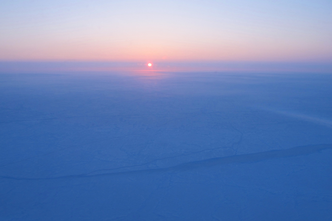 Sunrise over sea ice near the North Pole.
