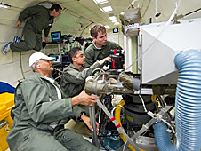 Dr. Vijay Vijayakumar of Aerfil, Juan Agui of NASA Glenn Research Center and Marco Adolph of Trox do Brasil test an air filtration system for long-duration spaceflight in Zero-G Corporation's modified Boeing 727.