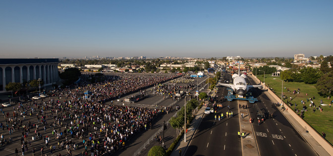 Thousands of spectators gathered in front of the Forum in Inglewood, Calif., as the space shuttle Endeavour stopped temporarily for a celebration as it headed overland to its new home at the California Science Center in Los Angeles on Saturday, Oct. 13, 2012.
