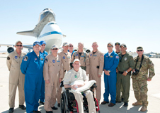 Los Angeles Police Department personnel and former NASA astronaut and Dryden test pilot Gordon Fullerton, seated, join the crew of the NASA 747 Shuttle Carrier aircraft.